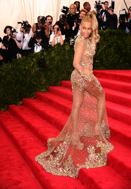 """Beyonce arrives at The Metropolitan Museum of Art's Costume Institute benefit gala celebrating """"China: Through the Looking Glass"""" on Monday, May 4, 2015, in New York. (Photo by Charles Sykes/Invision/AP Photo)"""