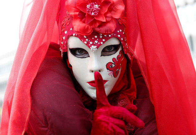 A masked reveller poses during the Venice Carnival in Venice, Italy February 12, 2017. (Photo by Tony Gentile/Reuters)