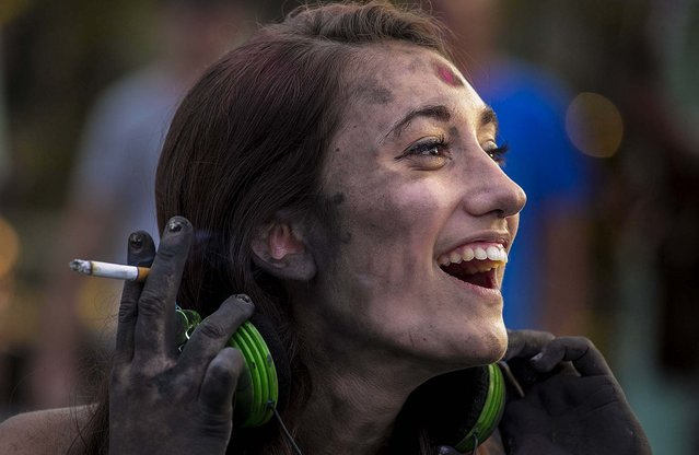 Kacee Weber, of Lake Worth, laughs during a break.  (Photo by Greg Lovett/The Palm Beach Post)