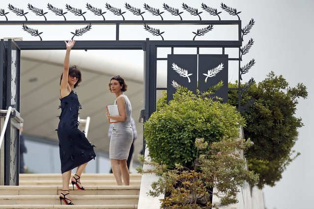 Jury member actress Sophie Marceau (L) waves as she arrives to attend a photocall before the opening of the 68th Cannes Film Festival in Cannes, southern France, May 13, 2015. (Photo by Benoit Tessier/Reuters)