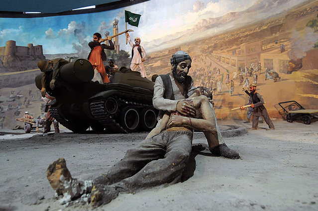 Detail of a tableau depicting victims of the Soviet invasion of Afghanistan, part of a display at the Jihad Museum, on August 8, 2009. (Photo by Shah Marai/AFP Photo via The Atlantic)