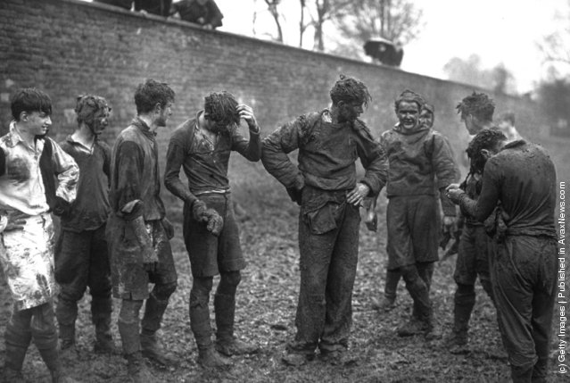 1939: Eton school boys covered in mud after taking part in the annual Wall Game
