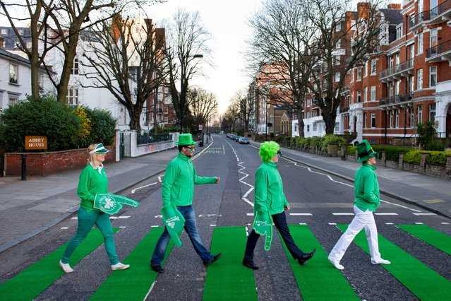 The zebra crossing on Abbey Road, St John's Wood, is turned green by Tourism Ireland to celebrate St Patrick's Day in London, on March 17, 2014. (Photo by Matt Crossick/PA Wire)