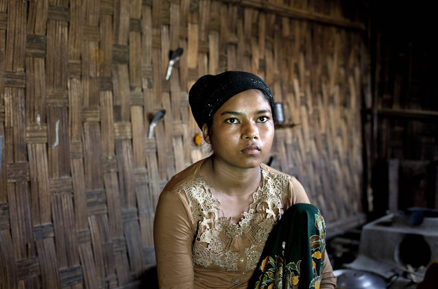 In this In this Tuesday, May 12, 2015, photo 17-year old Rorbiza rests at home in Dapaing, North of Sittwe, western Rakhine state, Myanmar, after escaping from a human trafficking boat. (Photo by Gemunu Amarasinghe/AP Photo)