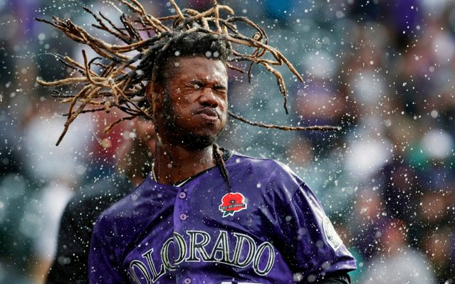 Colorado Rockies' Raimel Tapia shakes his head after being doused in celebration of his walk-off single off Arizona Diamondbacks relief pitcher Matt Andriese in the 11th inning of a baseball game, Monday, May 27, 2019, in Denver. The Rockies won 4-3. (Photo by David Zalubowski/AP Photo)