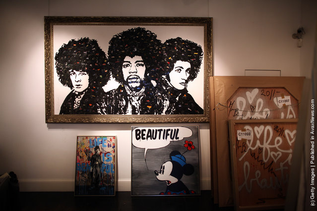 Works by artist Mr Brainwash are readied for exhibiting at the Opera Gallery