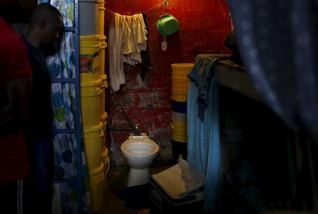An inmate looks at his toilet in his cell at the Pavilion No.6 assigned to foreigners at La Joya prison on the outskirts of  Panama City, Panama November 13, 2015. (Photo by Carlos Jasso/Reuters)