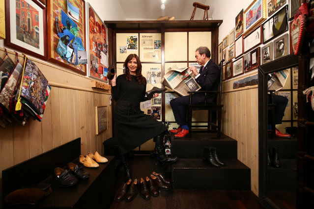 """Rosalina Dallago, 52, poses for a photograph at her shoeshine shop, Sciuscia Chic, in Rome, Italy, February 24, 2017. Former model Dallago owns three shoeshine shops. One of her shops is a tiny space on a narrow alleyway and is frequented mostly by lawmakers from the House of Parliament just around the corner. Her most loyal customers are legislators who stop by early in the morning on their way in. """"Sciuscia"""" is the fractured phonetic pronunciation that poor street urchins in Naples would shout out to U.S. soldiers after World War Two to ask them if they wanted their shoes shined. """"My customers see me as a professional before they see me as a woman"""", said Dallago. """"Mothers should instil a sense of gender equality in their sons"""". (Photo by Alessandro Bianchi/Reuters)"""
