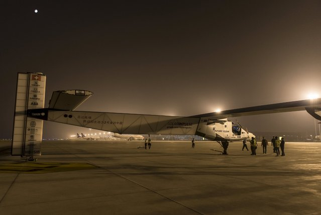Solar Impulse 2 -a solar powered plane- prepares to take off in Nanjing, China May 31, 2015. The world's largest solar-powered airplane, Solar Impulse 2, took off from eastern China's Nanjing on Sunday to continue its round-the-world voyage. The Swiss-made plane left Nanjing's Lukou International Airport at 2:39 in the early morning, with former fighter pilot Andre Borschberg at the controls alone for the entire 8,200-kilometer flight from Nanjing to Hawaii, the toughest leg of its marathon adventure.   REUTERS/Solar Impulse/Handout via Reuters