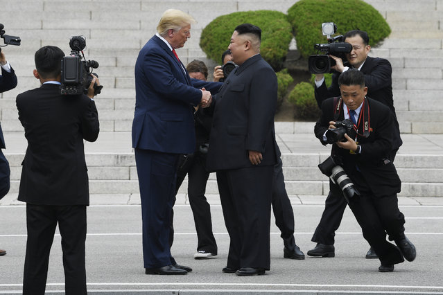 President Donald Trump walks to the North Korean side of the border with North Korean leader Kim Jong Un at the border village of Panmunjom in the Demilitarized Zone, South Korea, Sunday, June 30, 2019. (Photo by Susan Walsh/AP Photo)
