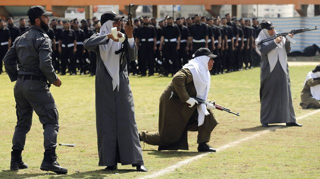 Female members of Palestinian security forces loyal to Hamas take part in a military graduation ceremony in Gaza City, on April 2, 2014. (Photo by Mohammed Salem/Reuters)