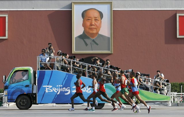Competitors run in front of the Tiananmen Gate with the portrait of Chairman Mao during the men's marathon at the Beijing 2008 Olympic Games, August 24, 2008. (Photo by Alfred Cheng Jin/Reuters)