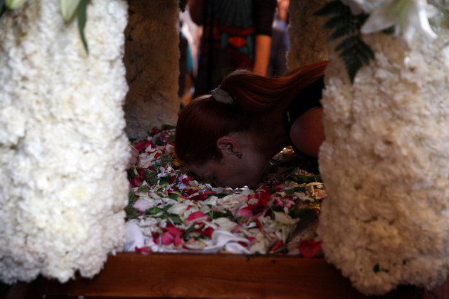 A Greek Cypriot orthodox faithful kisses an icon at an Epitaph during a Good Friday mass at a church of Ayios Georgios Exorinos in Famagusta, in the Turkish-administered northern part of Cyprus, April 29, 2016. (Photo by Yiannis Kourtoglou/Reuters)