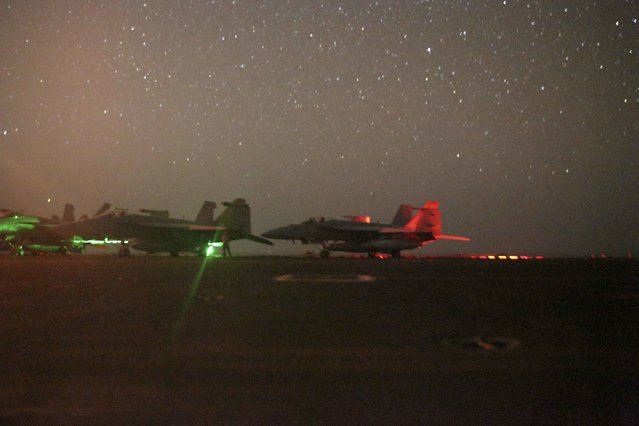 In this photo taken on Sunday, May 26, 2019 and released by the U.S. Navy, F/A-18 Super Hornets sit secured on the flight deck of the Nimitz-class aircraft carrier USS Abraham Lincoln in the Arabian Sea. (Photo by Mass Communication Specialist 3rd Class Jeremiah Bartelt/U.S. Navy via AP Photo)