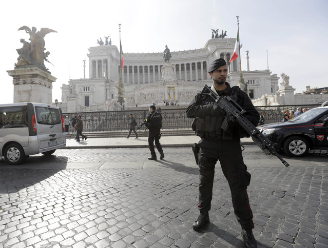 Italian paramilitary police patrol in front of the Monument of the Unknown Soldier in Rome's Piazza Venezia Square, on Friday, March 24, 2017 a day ahead of a European Union summit commemorating the 60th Anniversary of the Treaty of Rome. EU leaders are gathering in Rome for a summit to mark the EU's 60th anniversary and to outline its future after Britain leaves. (Photo by Gregorio Borgia/AP Photo)