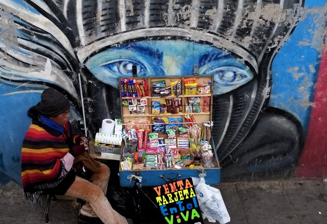 A street vendor sells candies and cigarettes in the centre of  La Paz, July 1, 2015. (Photo by David Mercado/Reuters)