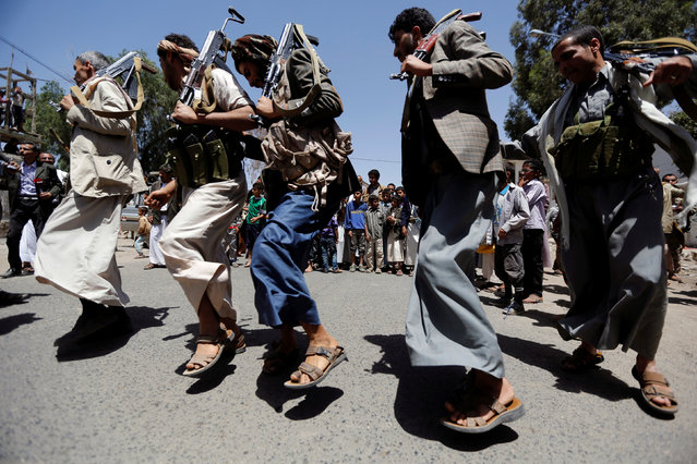 Tribesmen loyal to the Houthi movement perform the Baraa dance during a gathering to show support to the movement in Sanaa, Yemen, May 19, 2016. Bara or Baraa dance is one of the several traditional outdoor dances performed by men in the country of Yemen. Bara dance literally means a dagger dance, where each dancer holds a dagger. The style of the Bara dance differs from tribe to tribe. It is performed on special occasions. (Photo by Khaled Abdullah/Reuters)