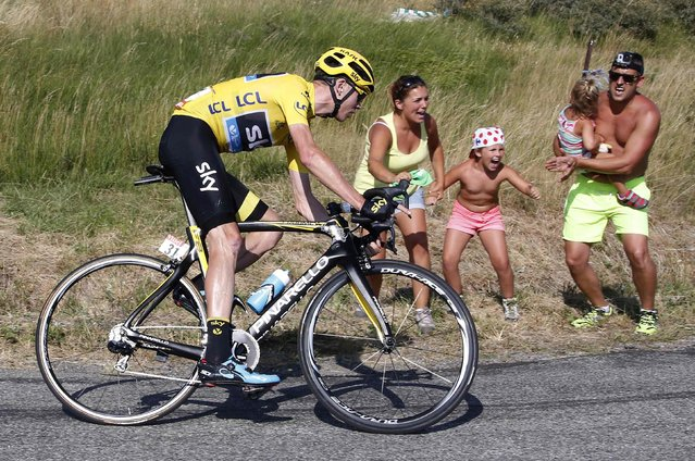 Team Sky rider Chris Froome of Britain, wearing the race leader's yellow jersey, speeds along the Manse pass during the 201-km (124 miles) 16th stage of the 102nd Tour de France cycling race from Bourg-de-Peage to Gap, France, July 20, 2015. (Photo by Eric Gaillard/Reuters)