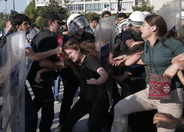 Turkish police clash with protesters in Istanbul, Tuesday, July 21, 2015, that tried to stage a march to denounce the deaths of a Monday explosion in the Turkish town of Suruc near the Syrian border. (Photo by Lefteris Pitarakis/AP Photo)