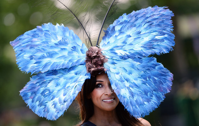 A race-goer shows off her butterfly hat on the opening day of Royal Ascot in London, Britain, June 17, 2014. Royal Ascot runs through June 21. (Photo by Andy Rain/EPA)
