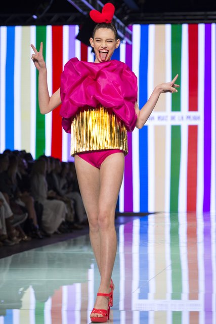 In this Sunday, June 4, 2017 photo, a model walks the runway wearing a design by Agatha Ruiz de la Parada on the final day of Miami Fashion Week at Ice Palace Film Studios in Miami. (Photo by Bryan Cereijo/Miami Herald via AP Photo)
