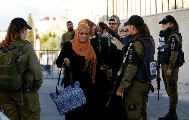 Israeli security officers search Palestinians at an Israeli checkpoint as they make their way to attend the first Friday prayer of the holy fasting month of Ramadan in Jerusalem's al-Aqsa mosque, in the West bank city of Bethlehem June 10, 2016. (Photo by Mussa Qawasma/Reuters)