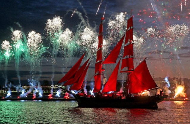 The Tre Kronor Stockholm brig sails along the Neva River as fireworks go off to mark the 2017 Scarlet Sails annual festival for St Petersburg school leavers on June 24, 2017. (Photo by Alexander Demianchuk/TASS)