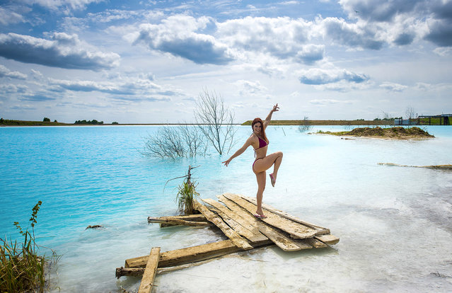 """In this undated handout photo taken by mrwed54, a woman poses for a photo by a lake in the Siberian city of Novosibirsk, about 2,800 kilometers (1,750 miles) east of Moscow, Russia. Thousands of Novosibirsk residents, from scantily clad women to newlyweds have been instagramming selfies near the lake nicknamed the """"Siberian Malvides"""" after the far-flung tropical islands in the Indian Ocean. This is in fact is a man-made dumb of coal from a nearby power station that provides for most of Novosibirsk's energy needs. Environmentalists are warning people against coming into contact with the water. (Photo by mrwed54 via AP Photo)"""