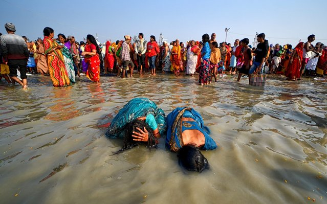 Hindu devotees taking a Holy Bath during the festival. Gangasagar is one of the religious spots for Hindu Pilgrims situated at the Bay of Bengal where millions of devotees come to take a Holy bath annually during Makar Sankranti (Transition of the Sun) as per Hindu calendar and offer prayers to Kapil Muni Temple. The date for this Festival usually fall between 13 to 15 January of every year. (Photo by Avishek Das/Echoes Wire/Barcroft Media via Getty Images)