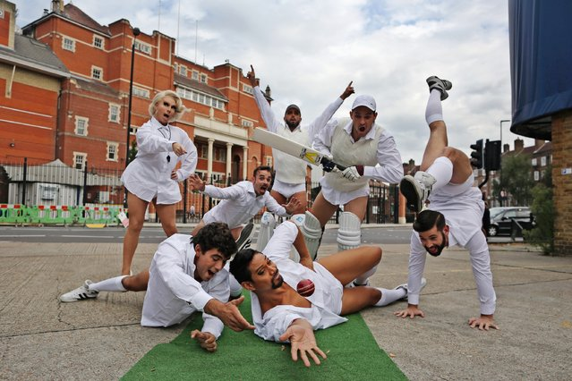An Australian drag circus act pose for pictures during a photocall outside The Oval cricket ground on August 12, 2015 in London, England. The photocall comes one week ahead of the fifth and final Ashes Test Match at the ground when England will regain the Ashes trophy after already securing an unsurmountable lead. (Photo by Dan Kitwood/Getty Images)
