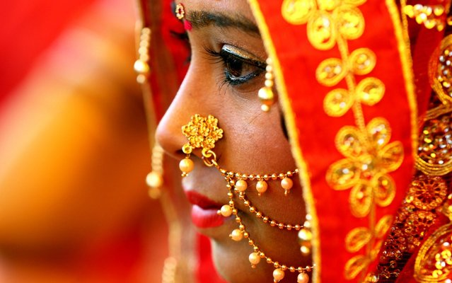 Indian bride takes part in a mass marriage ceremony under chief minister's welfare scheme (Mukhyamantri Kanyadan Yojna) on the occasion of the Basant Panchami festival, in Bhopal, India, 30 January 2020. Reports state, some 600 couples tied up the nuptial knot in various mass marriage ceremonies in Bhopal on Basant Panchami day, which is considered auspicious for marriages. Some communities undertake the responsibility of arranging mass marriages for couples belonging to the financially weaker caste of the society. (Photo by Sanjeev Gupta/EPA/EFE/Rex Features/Shutterstock)