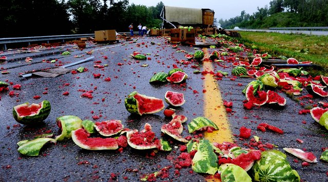 Splattered watermelons and tomatoes litter the roadway after an accident on the Breathitt-Pennyrile Parkway near Sebree, Kentucky