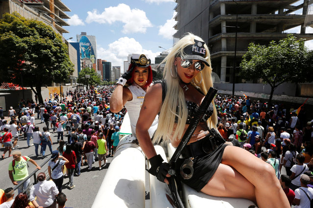 Revellers pose for a picture during the gay pride parade in Caracas, Venezuela July 03, 2016. (Photo by Carlos Jasso/Reuters)