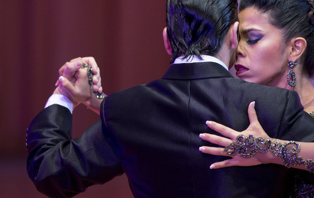 Colombian dancers Liliana Macchiabello and Alejandro Triunveri compete in the first round of the stage category at the World Tango Championship in Buenos Aires, Argentina, Thursday, August 20, 2015. Hundreds of couples from around the world are competing in the championship's two categories: salon, and stage. (Photo by Natacha Pisarenko/AP Photo)