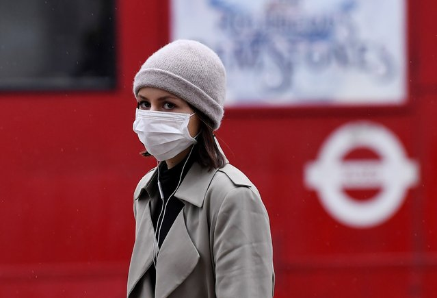 A woman wears a face mask in Oxford Circus, London, England during the global outbreak of the Coronavirus disease on February 28, 2020. (Photo by James Veysey/Rex Features/Shutterstock)