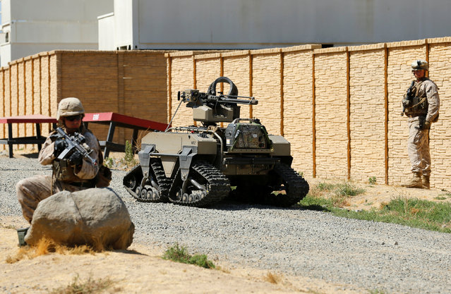 U.S. Marines patrol with a Multi-Utility Tactical  Transport (MUTT) as part of the Rim of the Pacific (RIMPAC) 2016 exercises held at Camp Pendleton, California United States, July 13, 2016. (Photo by Mike Blake/Reuters)