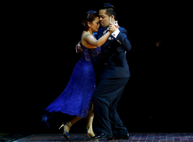Gennysam Delos Reyes Alcantara (R) and Lily Tan from Singapore dance during the Salon style final round at the Tango World Championship in Buenos Aires, Argentina, August 26, 2015. (Photo by Marcos Brindicci/Reuters)
