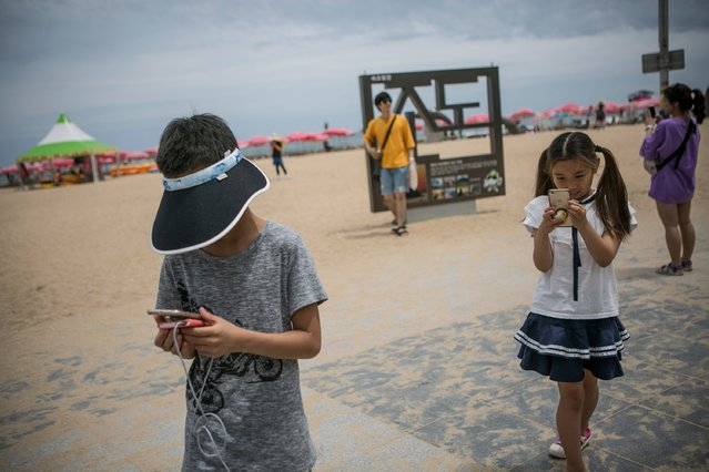 South Korean children play Pokemon Go on July 15, 2016 in Sokcho, South Korea. (Photo by Jean Chung/Getty Images)