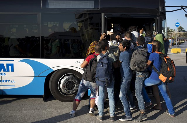 "Migrants try to get on a bus following their arrival onboard the Eleftherios Venizelos passenger ship at the port of Piraeus near Athens, Greece, August 29, 2015. The International Organization for Migration says 1,500-2,000 migrants are taking the route through Greece, Macedonia and Serbia to Hungary every day and that there is ""a real possibility"" the flow could rise to 3,000 daily. (Photo by Stoyan Nenov/Reuters)"