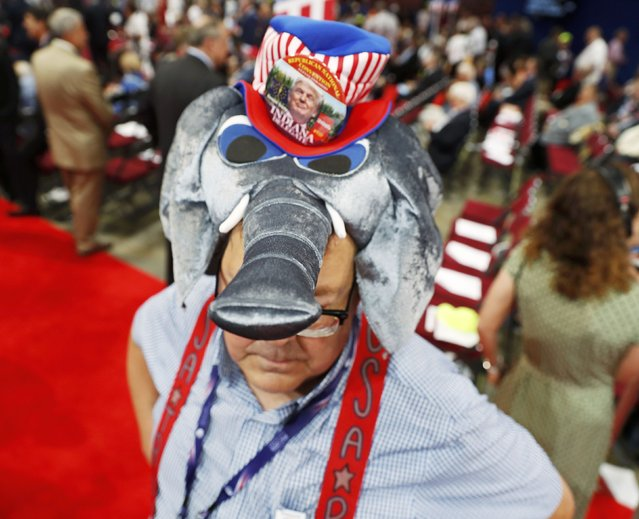 A convention goer wears a GOP mascot elephant hat at the Republican National Convention in Cleveland, Ohio, U.S. July 18, 2016. (Photo by Jonathan Ernst/Reuters)