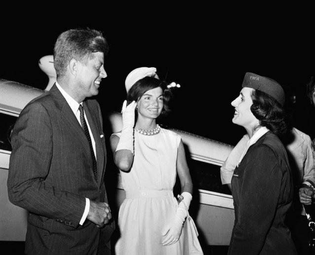 Senator John F. Kennedy of Massachusetts and his wife, Jacqueline, center, talk to stewardess Andree Picq at New York's Idlewild Airport on July 8, 1960. The Kennedys flew in from the family home at Hyannis, Mass., in the plane in background. Kennedy will leave New York following day for Los Angeles and the Democratic National Convention. His wife, who is expecting their second child, will return home. Miss Picq, a native of France and now a U.S. citizen, said she would cast her first presidential vote for Kennedy if his party's convention nominates him. (Photo by Matty Zimmerman/AP Photo)