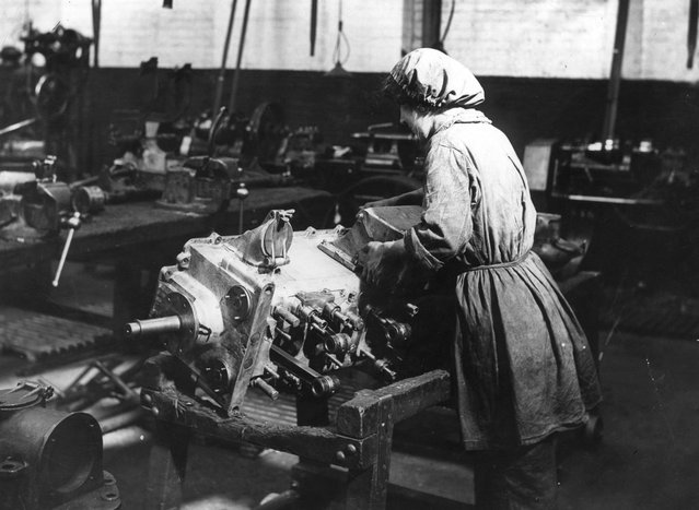 A Woman working on an engine in an engineering shop, circa 1915. (Photo by Topical Press Agency)