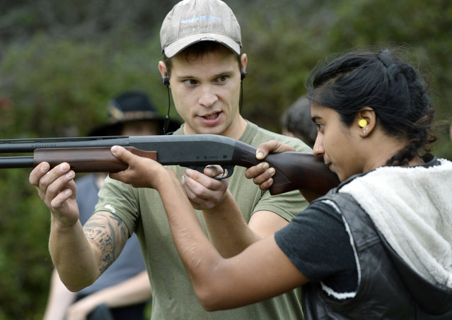 In this October 8, 2017, photo, Jon Falstaff, left, gives Mohini Sharma instruction on holding and firing a shotgun during a training session for the Trigger Warning Queer & Trans Gun Club in Victor, N.Y. (Photo by Adrian Kraus/AP Photo)