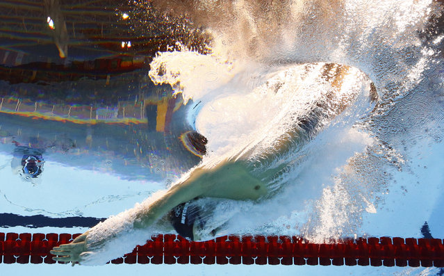 Tunisia's Oussama Mellouli starts during the men's 1500-meter freestyle heat during the swimming competitions at the 2016 Summer Olympics in Rio de Janeiro, Brazil, Friday, August 12, 2016. (Photo by Lee Jin-man/AP Photo)