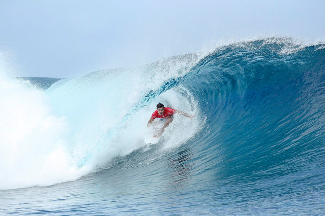 A handout picture made available by the World Surf League (WSL) shows Julian Wilson of Australia winning his Round 2 heat at the Billabong Pro Tahiti 2016 in Teahupo'o, Tahiti, French Polynesia, 22 August 2016. (Photo by Kelly Cestari/EPA)