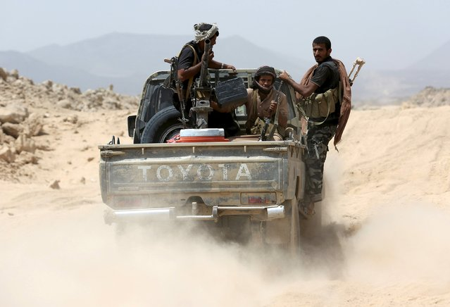 Tribesmen loyal to Yemen's government ride on a pick-up truck in the frontline province of Marib, September 20, 2015. (Photo by Reuters/Stringer)