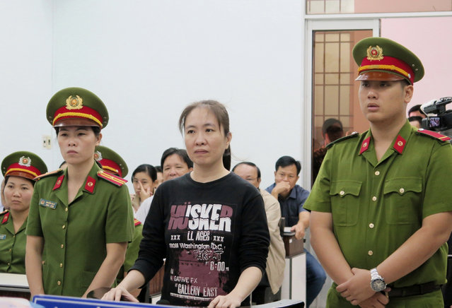 Nguyen Ngoc Nhu Quynh, center, a prominent Vietnamese blogger, stands trial in south central province of Khanh Hoa, Vietnam, Thursday, November 30, 2017.  A Vietnamese appeals court upheld a blogger's 10-year prison sentence for Facebook posts alleged to be anti-state propaganda, her lawyer said Thursday, in the second tough sentence imposed on dissidents in a week that drew a rebuke from the U.S government. Nguyen Ngoc Nhu Quynh was convicted in June of spreading propaganda by distorting government policies and defaming the Communist regime. (Photo by Tien Minh/Vietnam News Agency via AP Photo)