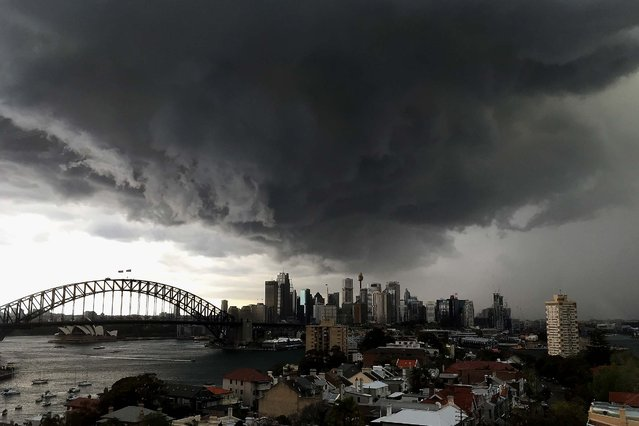 A storm approaches the Sydney central business district on September 25, 2014 in Sydney, Australia. The Bureau of Meterology issued a severe thunderstorm warning predicting rain and possible hail. (Photo by Cassie Trotter/Getty Images)