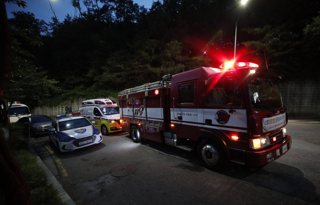Fire, ambulance and police vehicles are seen in front of a park in Seoul, South Korea, Thursday, July 9, 2020. Police say Seoul Mayor Park Won-soon has been reported missing and search operations are underway. (Photo by Lee Jin-man/AP Photo)