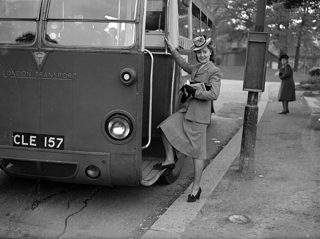 Winifred Shotter, the new television announcer stepping onto a London Transport bus. 3rd May 1946. (Photo by Stanley Sherman/Express)